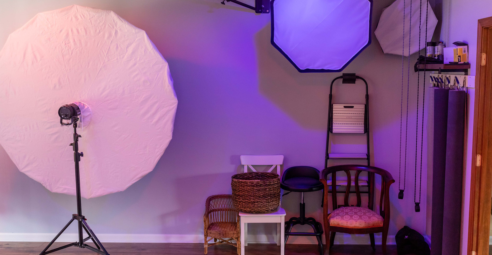 Multiple seating options and lighting modifiers (soft boxes, beauty dishes, umbrellas).