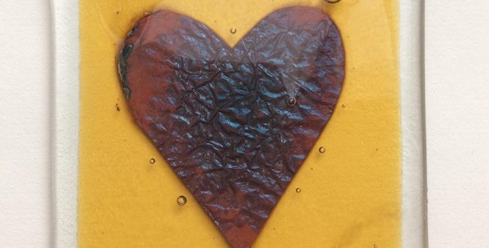 Amber coaster with copper heart
