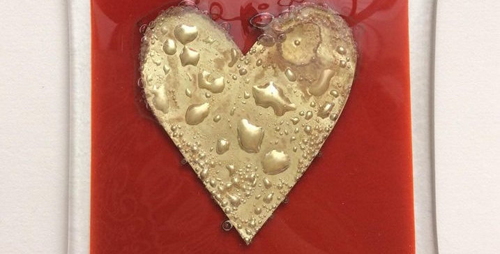 Red coaster with gold heart