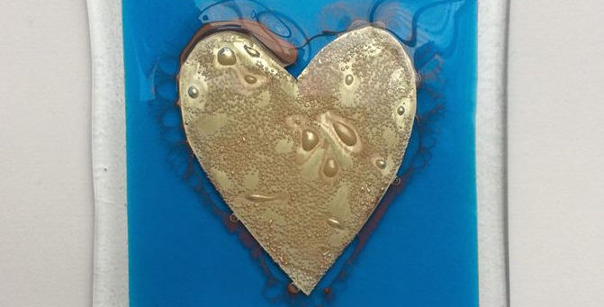 blue coaster with gold heart