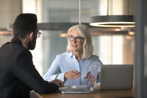 Mature businesswoman talking with busine