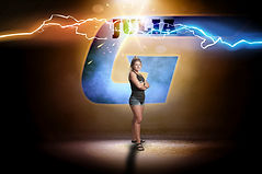 A young woman stands in front of a stylized logo with her name and colored lightning overhead.