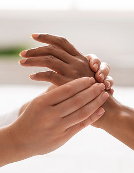 Hand massage. Female therapist pressing