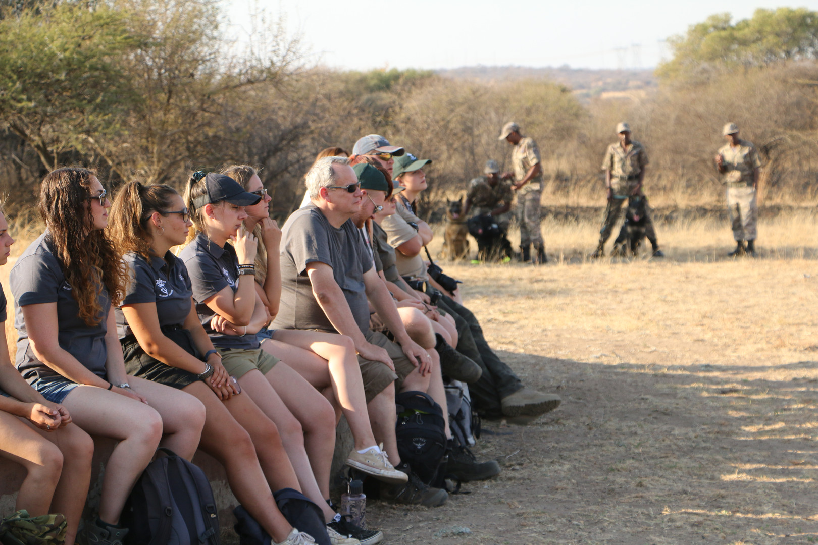 Volunteers Observing Anti Poaching Dogs in Action