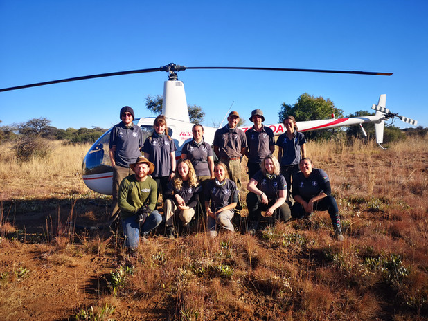 Volunteers With Helicopter