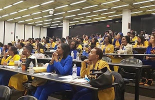 Sorors listening intently to information