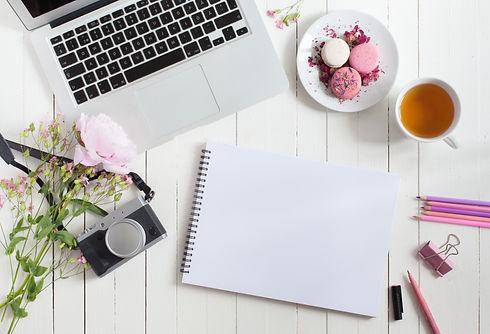 Feminine flat lay workspace with laptop,