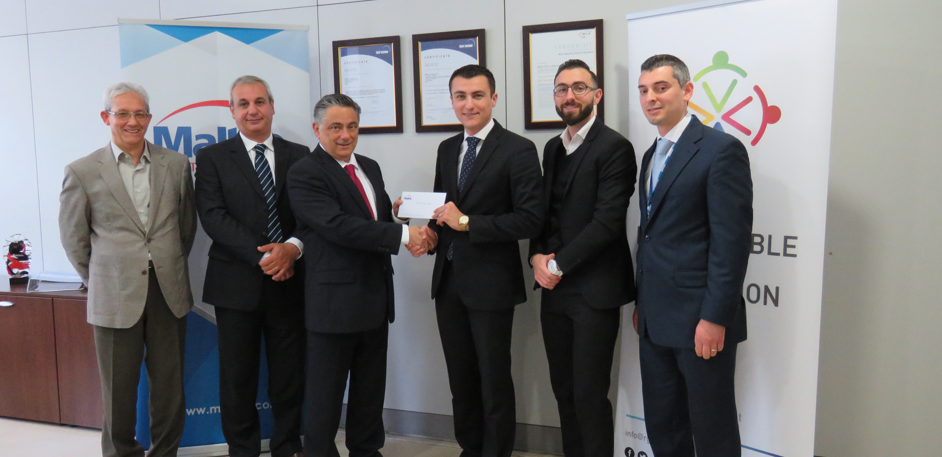 Maltco presents a cheque of €6,000 to the RGF for a scholarship at the UOM on responsible gaming research