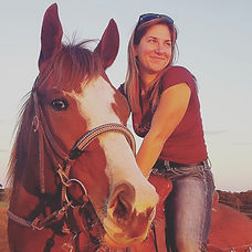 Dr. Tina Grove riding one of her horses.