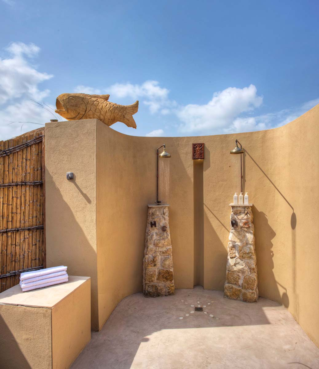 Azura Benguerra Royal Beach Villa outdoor showers