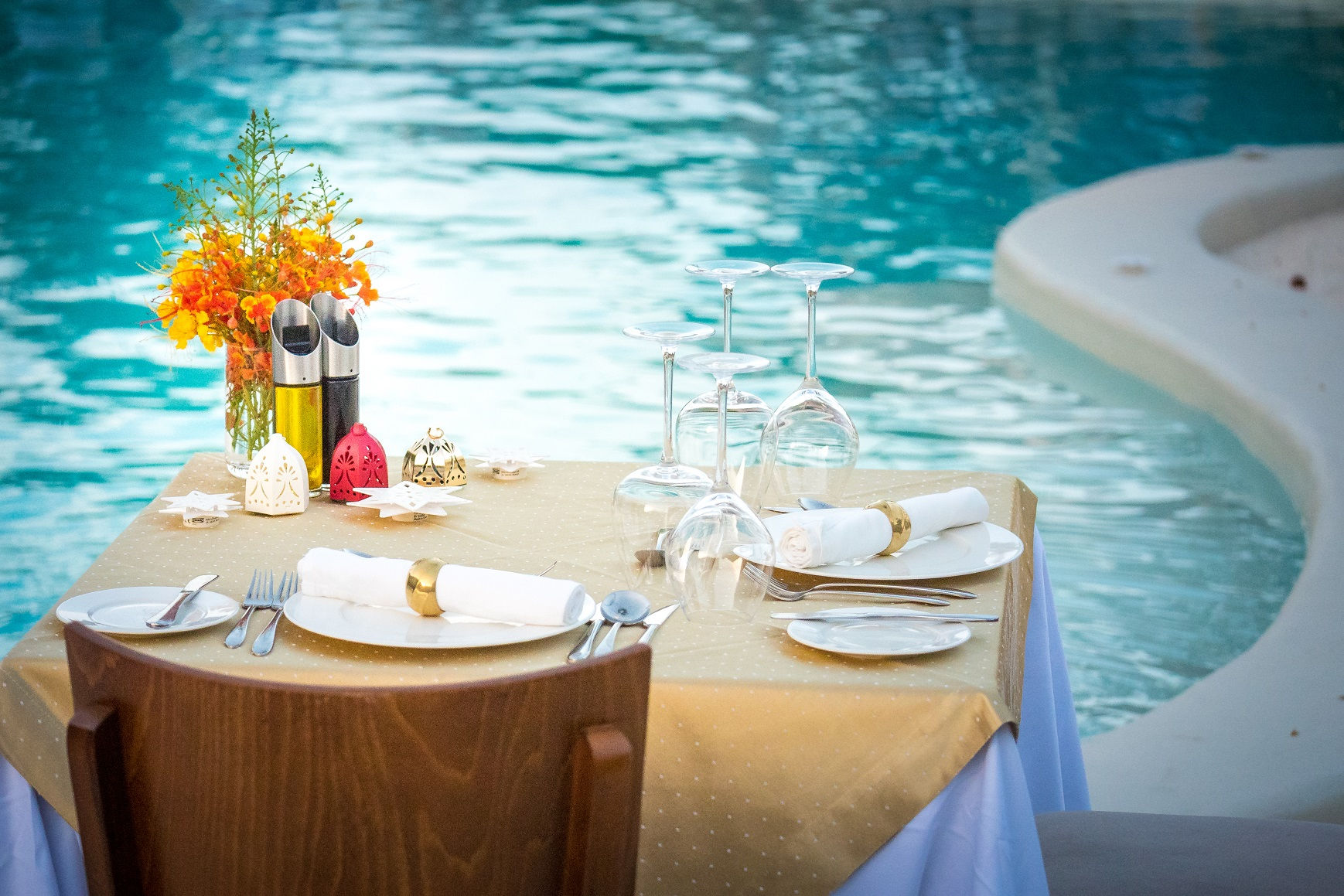 Table for two by the pool
