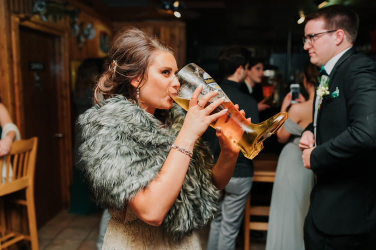 Bride Drinking Out of Beer Boot