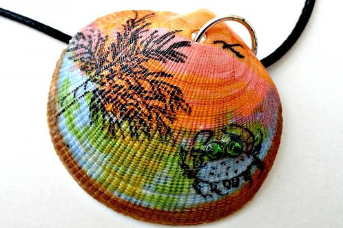Painted shell with sunset, palm tree and crab