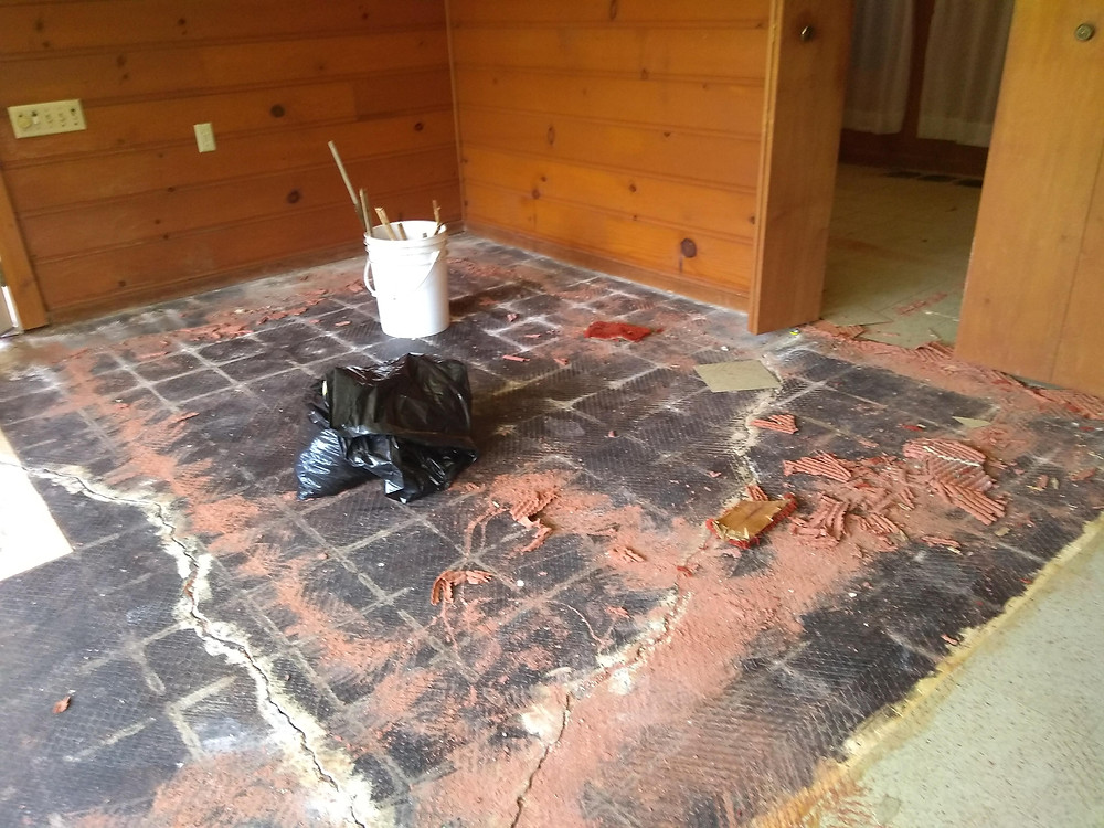 VTC and black mastic in a home