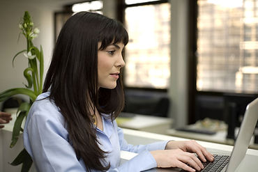Woman at desk typing