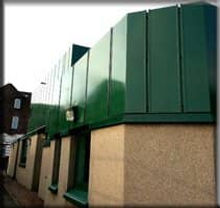 Closeup of green metal building restored to look new with Everbrite