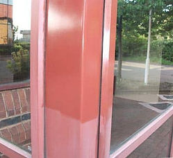 Salmon colored anodized aluminum window frame partially restored with Everbrite
