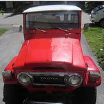 Red Toyota Jeep half faded and oxidized and half restored to look new again with Everbrite
