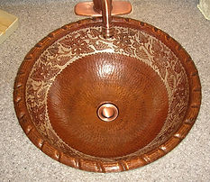 Hammered Copper Sink with designs is coated to preserve the patina and designs.