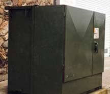 Dark green utility box that has been restored with Everbrite to look new again.