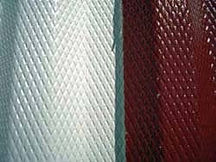Closeup of Red and white metal siding on airplane hangar that has been restored to look new with Everbrite.