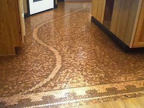 Copper Penny floor with an intricate pattern of old and new pennies coated with ProtectaClear to maintain the copper floor.