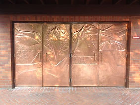 Intricate copper doors restored and coated with ProtectaClear to look new again.