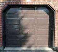 Brown Garage Door faded next to restored door with Everbrite that looks new
