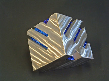 Shiny polished stainless steel cube sculpture coated with ProtectaClear to prevent tarnish.