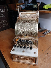 Antique brass cash register that has been restored with ProtectaClear