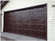 Brown garage door sealed and restored with Everbrite to look new again
