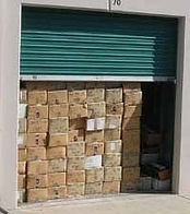 Storage unit full of cardboard boxes that would get wet if water gets in the unit.