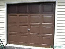 Single brown garage door that is restored with Everbrite to look new again