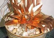 Copper Sculpture of flowers and leaves in pot coated with ProtectaClear