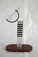 Aluminum sculpture with walnut wood protected with ProtectaClear