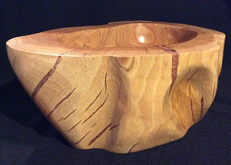 Carved wood bowl with copper in the cracks is sealed and protected with ProtectaClear.