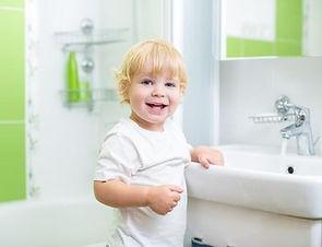 child-touching-sink.jpg