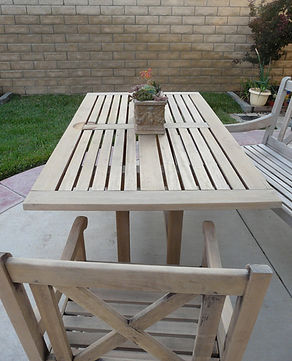 Teak Patio table and chairs faded to white from sun damage
