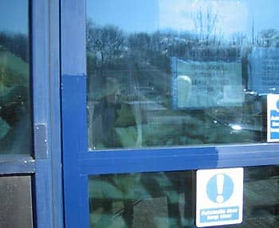 Blue anodized aluminum window frame partially restored with Everbrite
