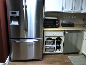 Stainless steel refrigerator and dishwasher protected from fingerprints and smudges with ProtectaClear.