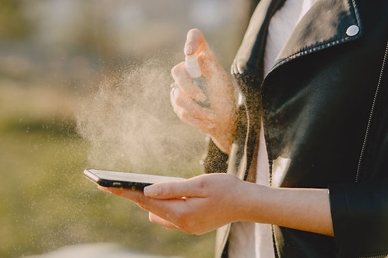 woman-treats-her-phone-with-antiseptic-A