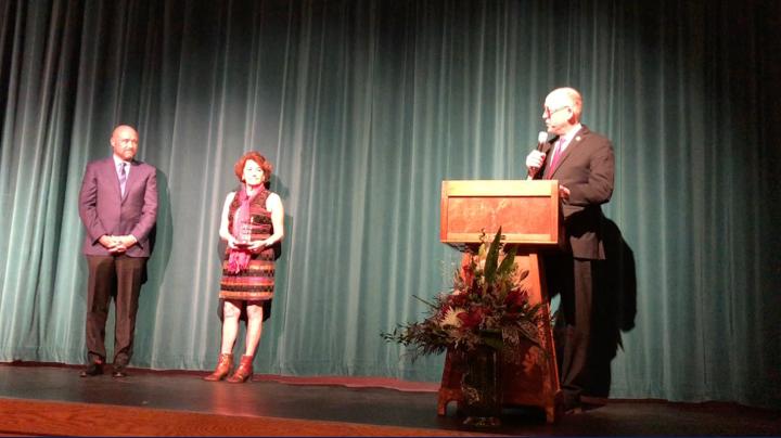 Congressman Walden presents Rep. Smith with award.