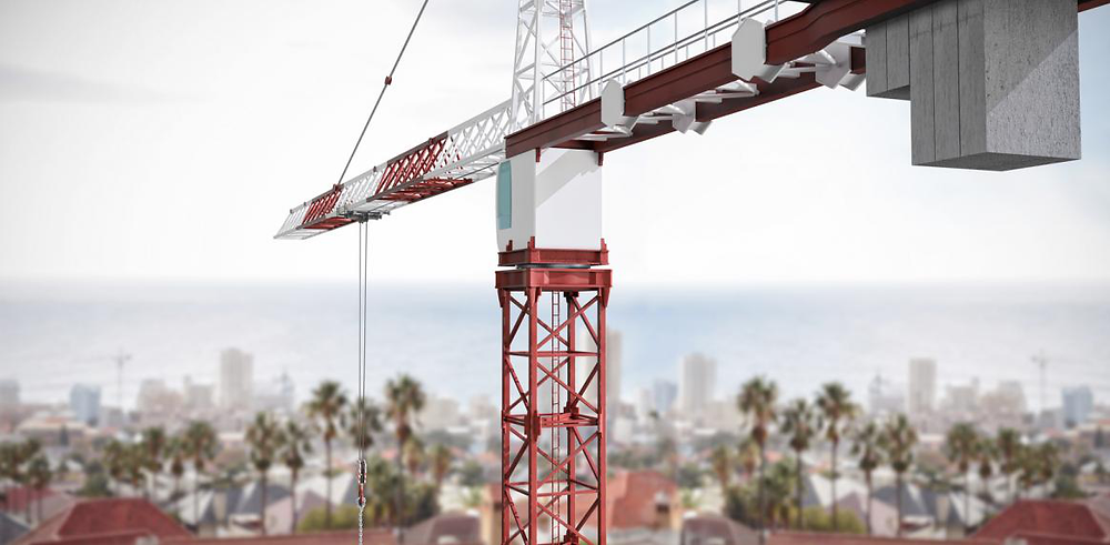 Studio Shoot of a crane against a large city on the horizon.