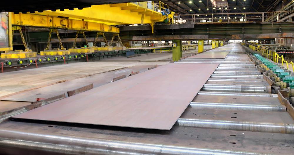 A thick sheet of steel ready to be lifted by a magnet lifting device.