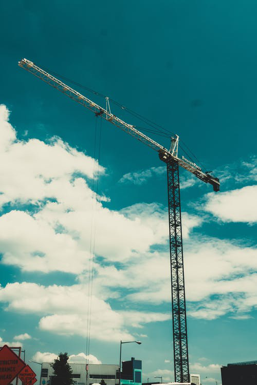 A crane lifting loads within its capacity because of overload protective devices.