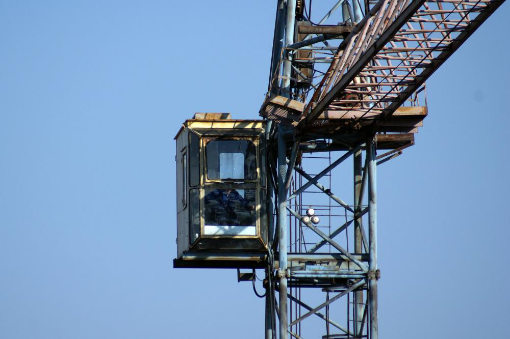 a tower crane' operator cab against the sky.