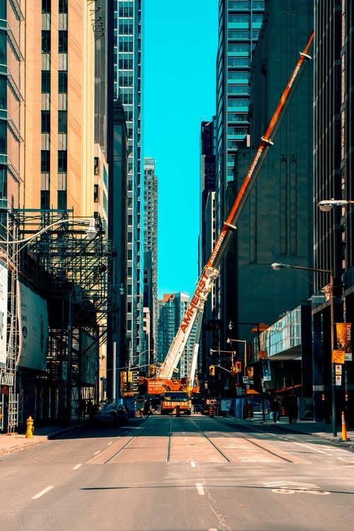 an orange crane on the road
