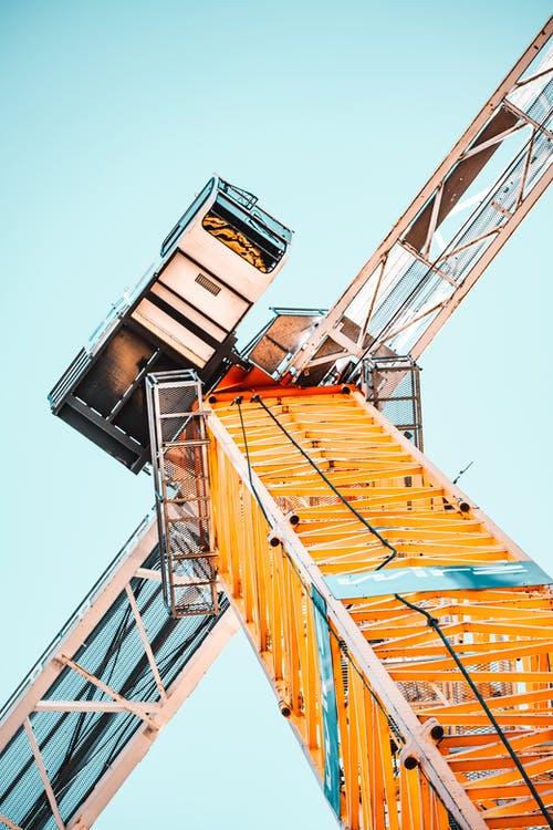 an orange tower crane