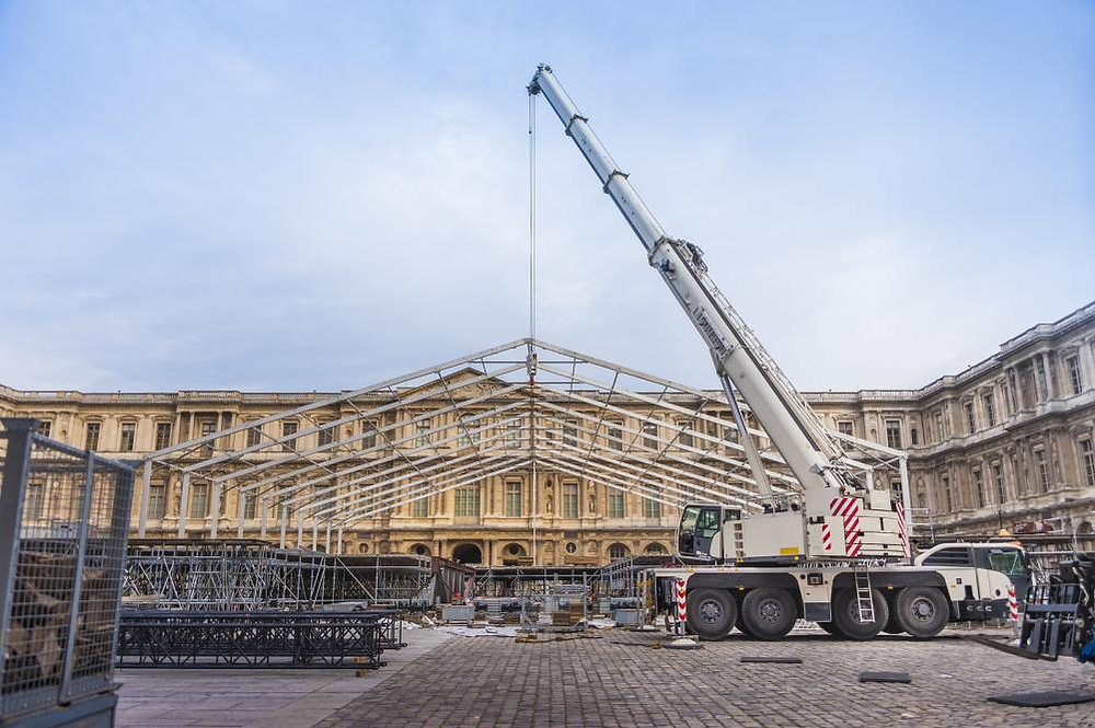 a mobile construction crane erecting a temporary structure