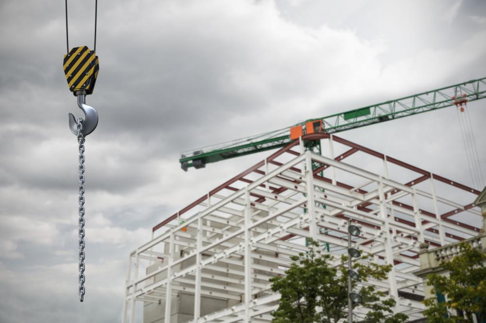 Studio Shoot of a crane lifting hook against crane at the construction site.
